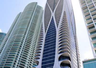 Photograph of the exterior of One Thousand Museum condo with surrounding buildings.