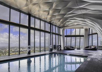 Photograph of the indoor pool at One Thousand Museum condo.